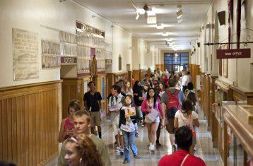 Students in a crowded school hallway.